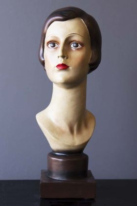 lifestyle image of Deco Female Head/Bust Figurine on black table with grey wall background