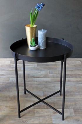 Lifestyle image of the Dream Black Tray Table with vases with dark wall and wooden floor
