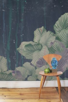 lifestyle image of Elli Popp Issey - Nymph on the Waters Wallpaper - Green with wooden chair and blue and green ornaments