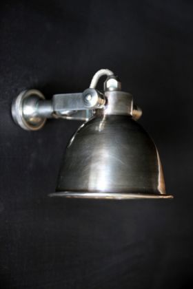 lifestyle image of Fabulous Wall Light - Antique Silver on black background side view