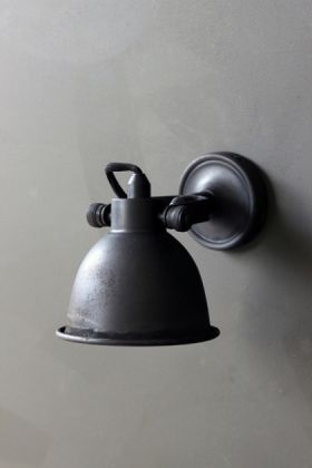 fabulous wall light - black turned off on grey wall background lifestyle image