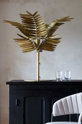 Lifestyle image of the Glorious Gold Palm Table Lamp