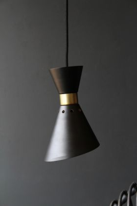 lifestyle image of Grace Black & Gold Pendant Light with grey wall background