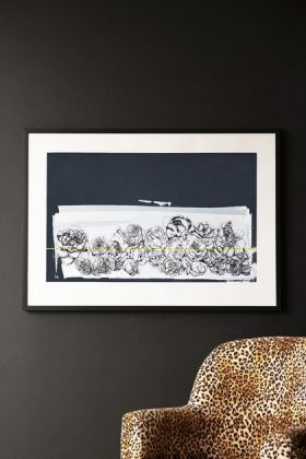 Lifestyle image of Hand Screen Printed Floral Portobello Landscape Artwork By Lizzie Coles hanging on dark grey wall above Rockett St George Leopard Love Armchair
