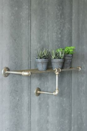 lifestyle image of Industrial Shelving - One Tier Shelf with three plants in grey pots on top and grey wall background