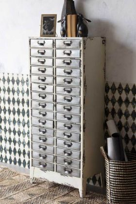 Lifestyle Image of the Industrial-Style Filing Drawer Storage Cabinet on a wooden floor and patterned wall background
