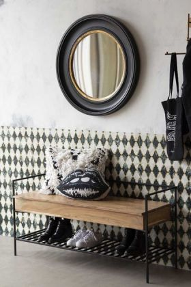 Lifestyle view of the Industrial-Style Iron & Wood Storage Bench with round mirror and lips cushion on a white wall background