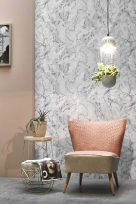 lifestyle image of Koziel White Grey Marble Wallpaper with pink velvet chair under white ceiling light with plant on wall and plant on wooden side table