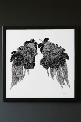 lifestyle image of Limited Edition Leaf Wings Art Print black and white wings made of leaves on white background in black frame and hung on dark grey wall