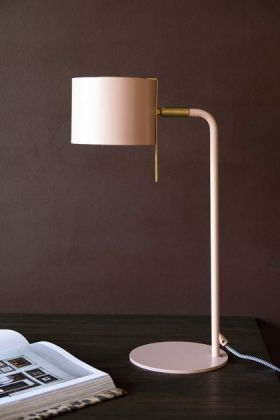 Lifestyle image of the Modern Gold Accent Table Lamp - Dusky Pink on black table with book and dark wall background