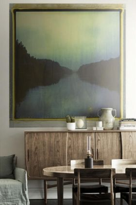 lifestyle image of Mr Perswall Wallpaper - Eco Dimensions - Passage 8132 behind wooden cabinet and dining table and chairs