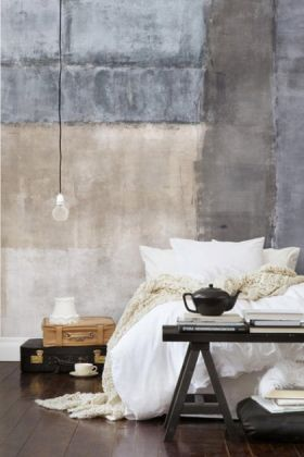 lifestyle image of Mr Perswall Wallpaper - Expressions Collection - Wallpainting P150101-4 in bedroom with bed with white bedding and black table at end and brown and black suitcases next to it and bulb ceiling light