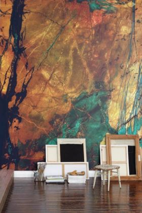 lifestyle image of mr perswall wallpaper - expressions collection - wilderness P151801-8 with mirrors and paintings on floor leaning against wall
