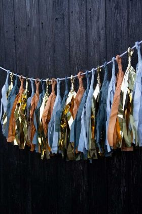 Lifestyle image of the Ochre Paper Tassel Garland