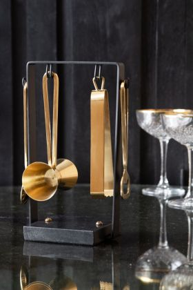 Lifestyle image of the Pikes At Rockett St George Gold 4-Piece Bar Kit & Black Marble Stand