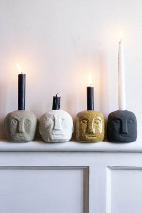 Lifestyle image of the Quirky Face Candle Holders on a mantelpiece