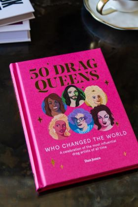 Image of the front cover of 50 Drag Queens Who Changed The World