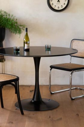 Lifestyle image of the 70's Inspired Black Round Dining Table