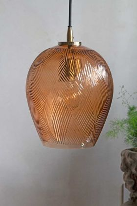 Lifestyle image of the Amber Tinted Glass Pendant Light With Zig-Zag Pattern