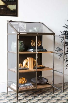 Lifestyle image of the Antique Brass Glass Display Cabinet with one door open