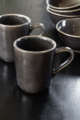 Lifestyle image of the Antique Black Dunes Stoneware Mug