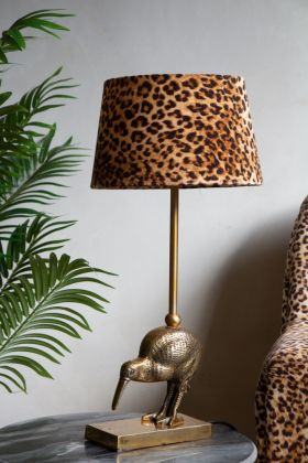 Image of the Antique Brass Kiwi Bird Table Lamp with a Rockett St George Leopard Love Lamp Shade on top