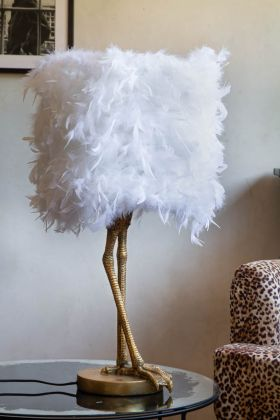 Lifestyle image of the Antique Gold Bird Leg Table Lamp With White Feather Shade