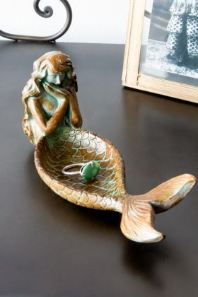 Right angled lifestyle image of the Antique Gold Mermaid Trinket Dish