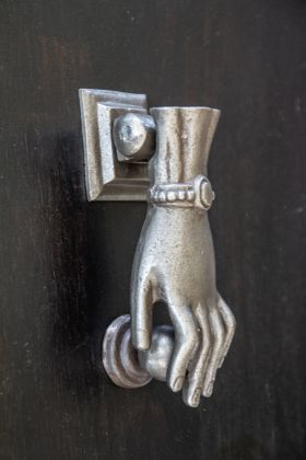 Side angle image of the Antique Style Iron Female Hand Door Knocker