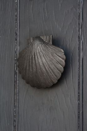 Angled image of the Antique Style Iron Scallop Shell Door Knocker