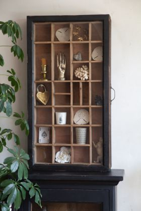 Front on lifestyle image of the Antiqued Wooden Wall Display Cabinet With Sliding Door