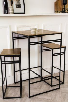 Angled lifestyle image of the Black & Gold Bar Set With Bar Table & Two Bar Stools