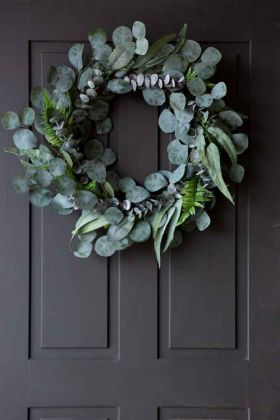 Lifestyle image of the Beautiful Eucalyptus & Fern Style Wreath hanging on a front door