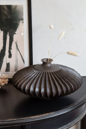Lifestyle image of the Beautiful Round Sunken Display Vase