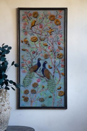 Image of the Bird Of Paradise Peacock Metal Wall Art hung on the wall