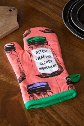 Lifestyle image of the Bitch I Am The Secret Ingredient Retro Oven Glove