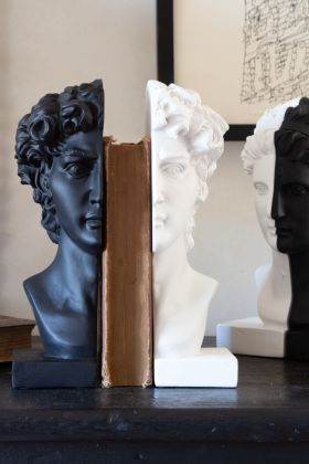 Lifestyle image of the Black & White Male Bust Bookends