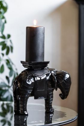 Lifestyle image of the Black Elephant Pillar Candle Holder