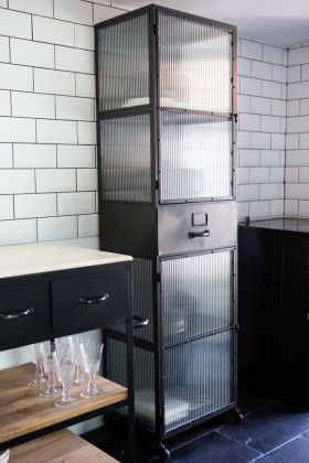 Lifestyle image of the Black Industrial Reeded Glass Storage Cabinet
