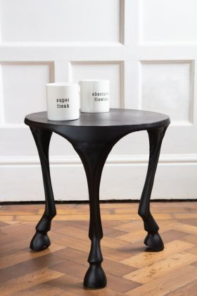 Lifestyle image of the Black Three Hoof Side Table