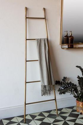 Lifestyle image of the Brass Storage Ladder For Towels