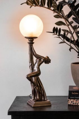 Lifestyle image of the Bronze Effect Natasha Art Deco Lady Table Lamp switched on