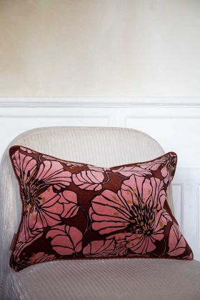 Lifestyle image of the Burgundy Red Dahlia Velvet Printed Cushion on a chair
