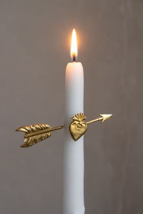 Close-up of the Cupid's Arrow Candle Decoration on a lit candle