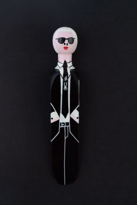 lifestyle image of fashion doorstop on black background karl lagerfeld