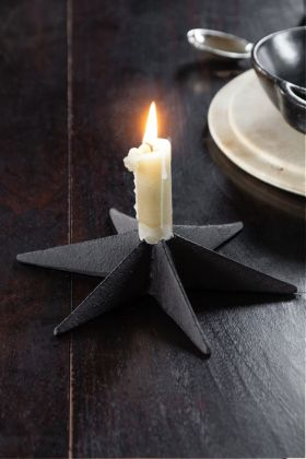 Image of the Cast Iron Star Candle Holder with a lit candle