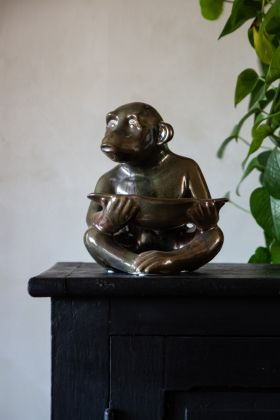 Lifestyle image of the Ceramic Green Monkey Dish Ornament