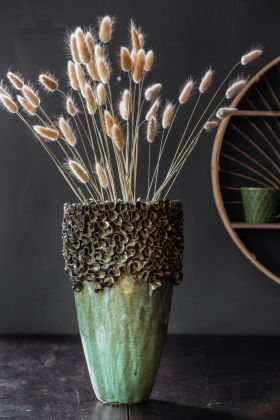 Lifestyle image of the Ceramic Green Vase with Faux stems in it