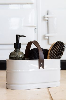 Image of the Chalk-Coloured Steel Storage Bucket With Leather Handle with grooming items