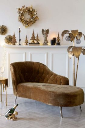 Christmas lifestyle image with the Easy Elegance Leopard Print Velvet Chaise Lounge & a bottle of Champagne